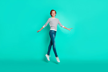 Full length size body photo portrait of beautiful pretty charming light confident attractive she her girl jumping up isolated turquoise background