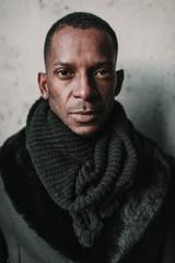 Adult black man in stylish warm clothes