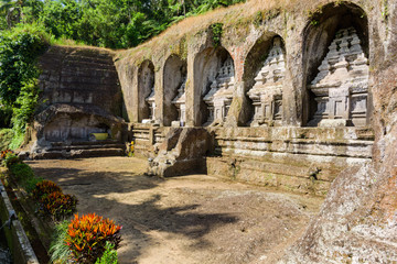 Candi Gunung Kawi hindu temple with niched carved stupas and water stream in Bali, Indonesia.