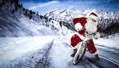 Santa Claus on winter road and snow decoration.
