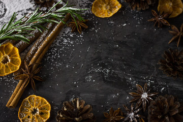 Christmas dark photo background with cinnamon and spices