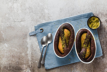 chocolate cake pudding with pear and pistachios without flour. gluten free. on the table . holiday dessert