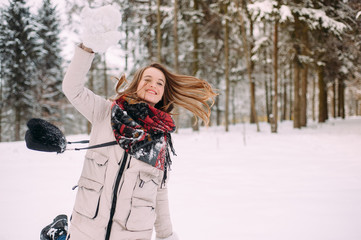 beautiful young girl posing at the camera, in the winter park