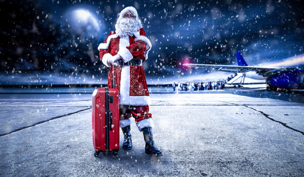 Red old Santa Claus and airport