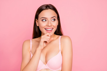 Close up portrait of wondered cute gorgeous attractive dreamy looking to sale with arm on chin her she lady girl wearing pale pink bra isolated on rose background