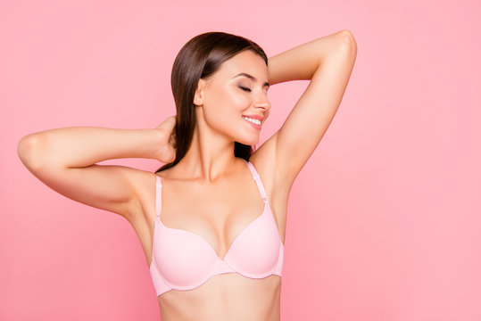 Close up portrait of gorgeous skinny cute lovely her she girl in salon relaxing of aroma sensitive procedure clear clean concept in bra eyes closed hands behind head isolated on pink background