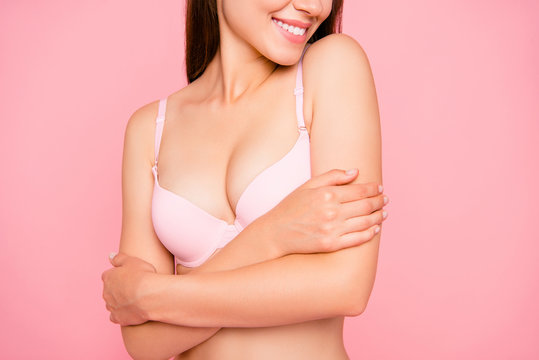 Cropped close up portrait of nice lovely gorgeous cute her she girl enjoying perfect softness of skin touching in pale pink bra isolated on pink background
