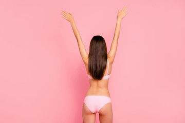 Back behind rear closeup view photo of long-haired thin skinny her she girl holding hands up in air showing good shapes in pale pink underwear isolated on rose background
