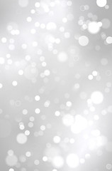 Abstract shiny silver background with blurred bokeh lights