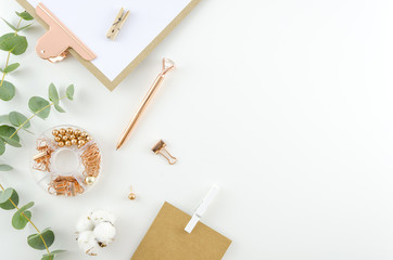 Flat lay, Top view office supplies table desk. Feminine desk workspace frame with green leaves eucalyptus, clipboard and cotton on white background. ideas, notes or plan writing concept. Hero header Wall mural