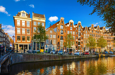 Fototapete - Amsterdam Netherlands. Traditional brown house at coast channel
