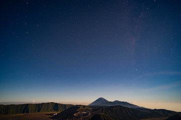 The stars in the night at the magnificent volcano Bromo is a foreground. Low-light and noise. in Indonesia.