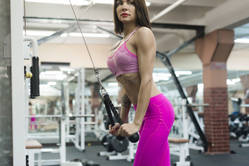 beautiful sexy woman of athletic build, engaged in workouts in gym, physical training of body. Healthy lifestyle concept. motivation and energy charge
