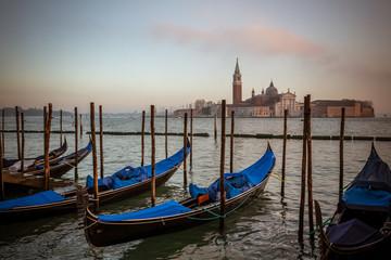 Gondolas in venice with the church of San Giorgio Maggiore