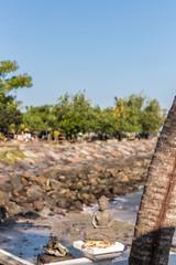 Buddha stone snall statue on the east of Bali island.