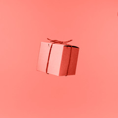 Seemless pattern of craft cardboard gift boxes on the solid pink background. Holiday and gift concept. Pop art slyle . Living coral theme - color of the year 2019