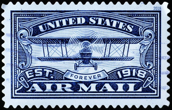 Old biplane on american air mail postage stamp