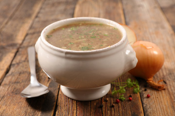 onion soup on wood background