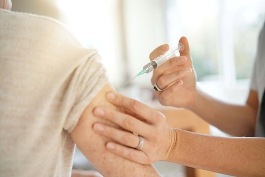 Close up of senior woman geting flu shot