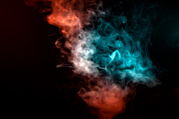 A translucent pattern of smoke, rising in a pillar to the top, illuminated by light on a black background in blue, gray and red colors, twisting in vortices, evaporating, exhaled from the vape.