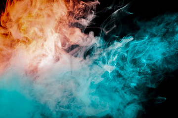 Flowing smoke on a black background, gray, blue, red, evaporating from the chemical compound vape, smoothly curling puffs of steam.
