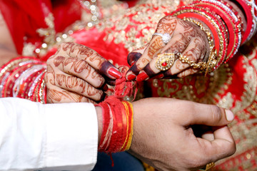 Indian couple playing Ring Fishing game in wedding ceremony of India