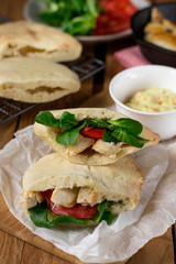 Homemade flatbread pita stuffed with chicken, lettuce and tomato