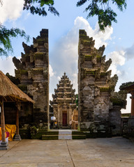 Aligned balinese split gate and candi entrance in Pura Kehen hindu temple, Bali, Indonesia.