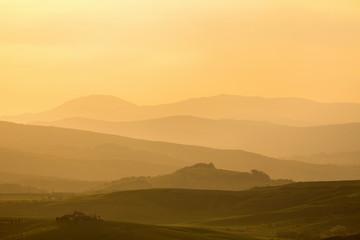 Sunset over a rolling landscape