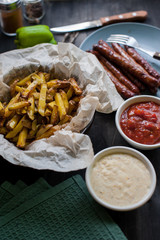 grilled sausages with french fries and vegetables