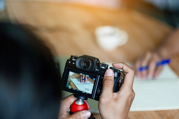 Hand and camera photographers are shooting. Concept photograph with copy space