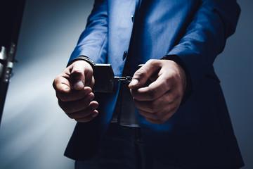 man hand handcuffs