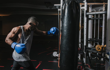 African American boxer training in gym