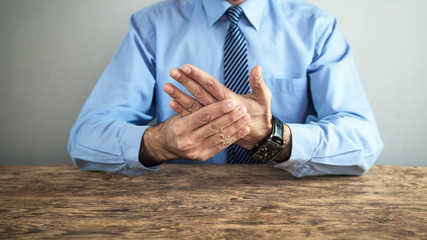 Businessman with wrist pain. Arthritis