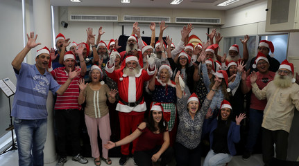 Students of Santa Claus school pose for a photograph during their classes in Sao Paulo