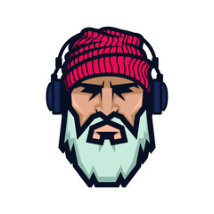 Bearded man in a knitted hat and headphones. DJ Hipster