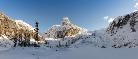 Beautiful Panoramic Canadian winter landscape during a bright sunny day. Taken in Watersprite Lake, near Squamish, North of Vancouver, BC, Canada.