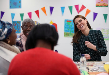 Britain's Catherine, Duchess of Cambridge, takes part in an arts and craft session with clients, during their visit to the homeless charity The Passage, in London