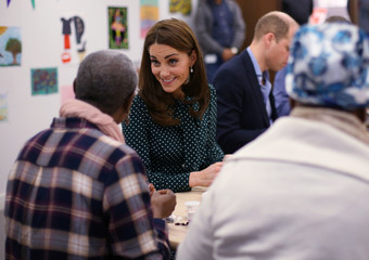 Britain's Catherine, Duchess of Cambridge, meets clients during a visit to the homeless charity The Passage, in London