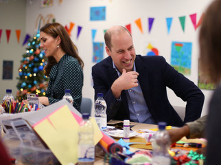 Britain's Catherine, Duchess of Cambridge, and Prince William take part in an arts and craft session with clients, during their visit to the homeless charity The Passage, in London