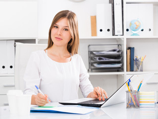 Young business woman at workplace