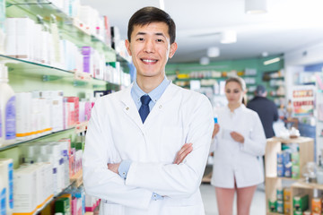 Positive korean man is standing with medicines