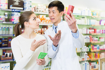 Active client asking pharmacist about medicines