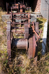 Rusty gears and winch mechanism.  Old machinery.
