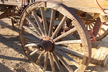 Wooden wagon wheel in old west tourist town