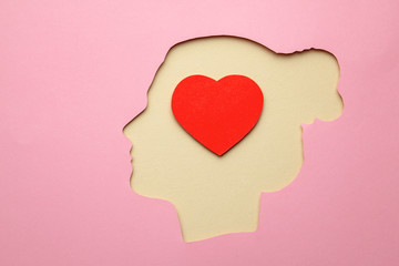 Silhouette of woman and inside the brain in the head heart as symbol of love Wall mural