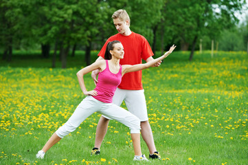 Personal training. fitness instructor exercising woman outdoors