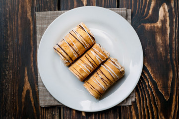 cake in  plate against wooden background