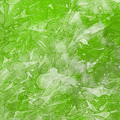 Watercolor green abstract texture with washes and brush strokes on the white paper background.