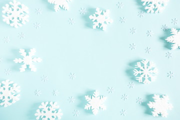 Christmas modern composition. Pattern made of snowflakes on pastel blue background. Christmas, New Year, winter concept. Flat lay, top view, copy space
